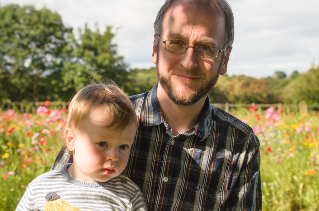 Martin and Jonah in front of the wild flowers