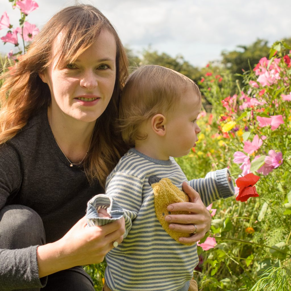 Jonah and Mummy crouching in the flowers