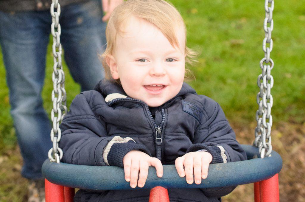 Jonah enjoying the swings at Birchfield Farm Pumpkin Festival