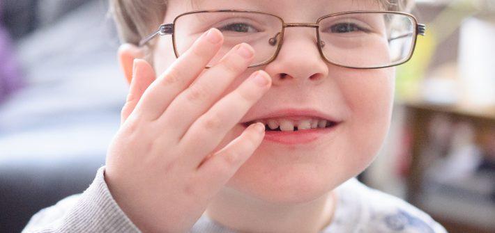 Jonah wearing daddy's glasses