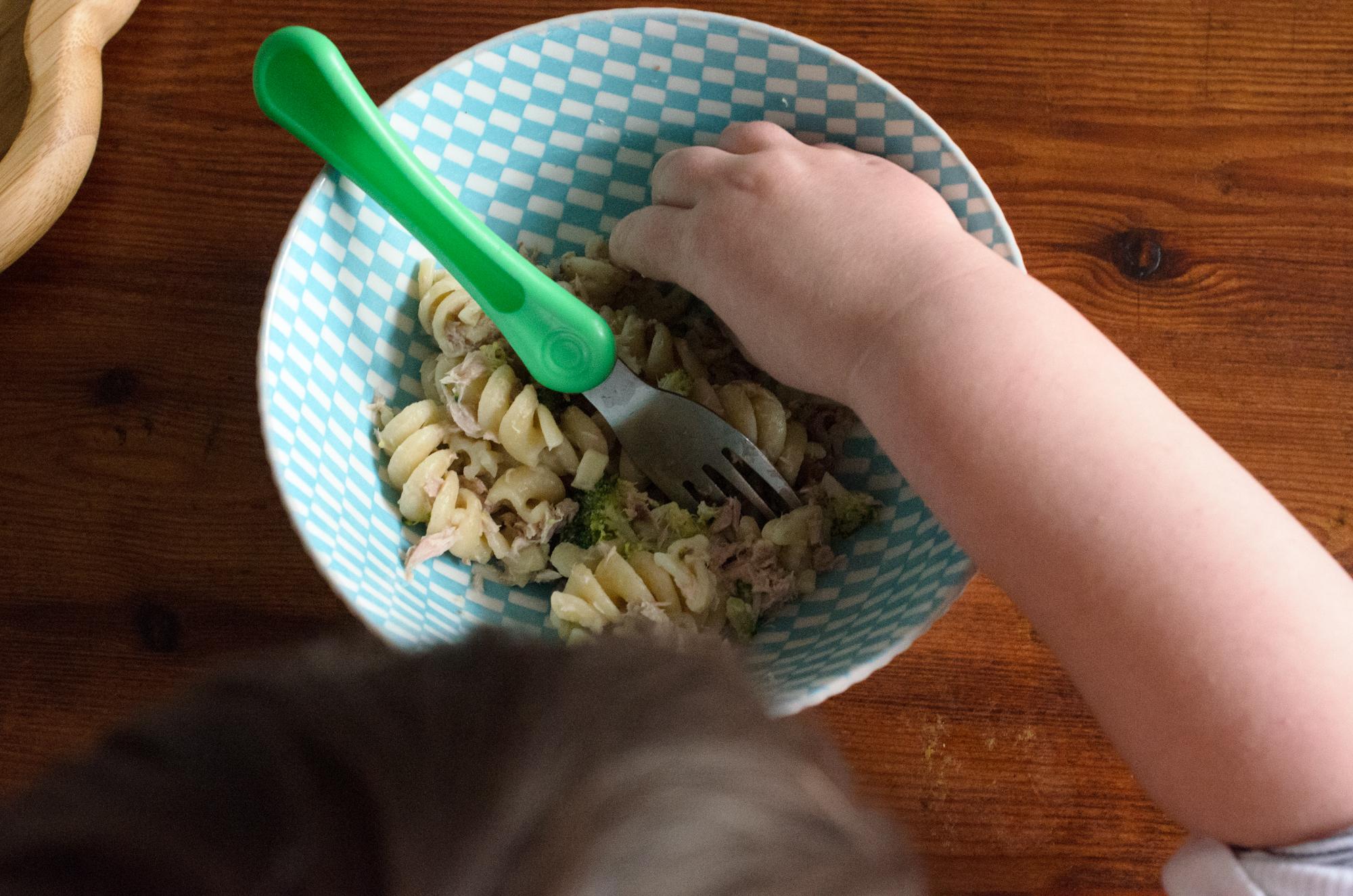 Jonah eating pasta