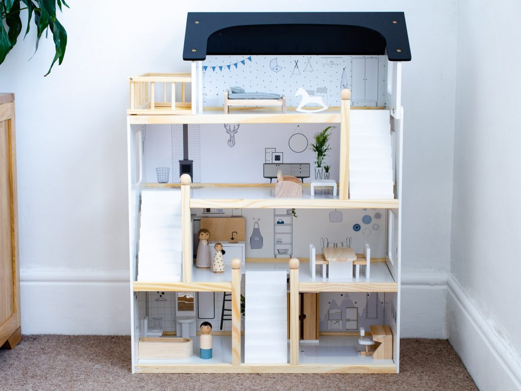The finished dolls house complete with furniture and dolls