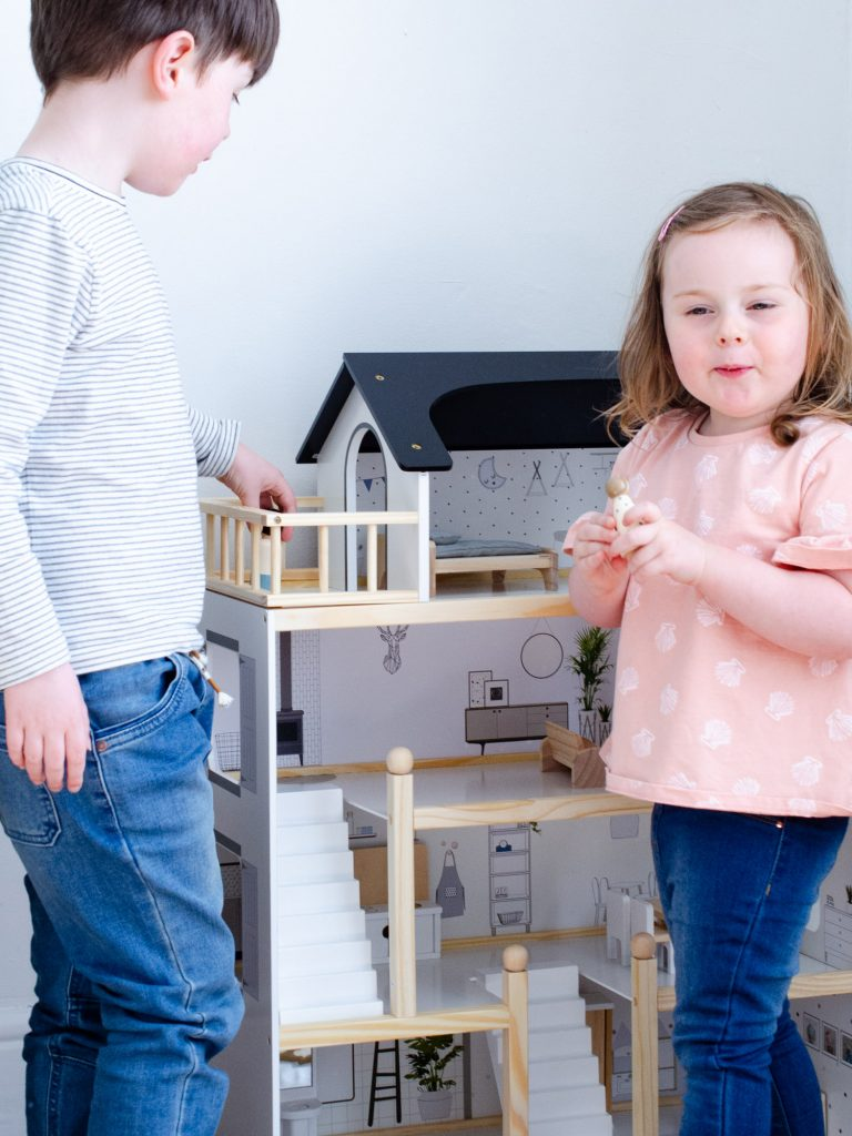 Playing with the dolls house together